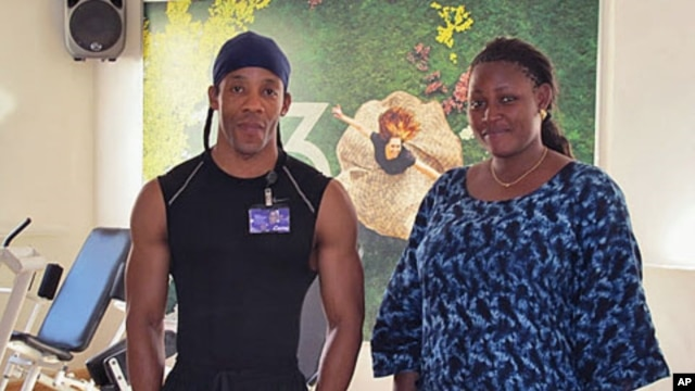 Fitness trainer Mickael Lafarge and one of his clients, Aissatou Sidime, before working out at a local gym in Dakar, Senegal, January