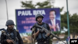 Members of the Cameroonian Gendarmerie patrols in the Omar Bongo Square of Cameroon's majority anglophone South West province capital Buea on October 3, 2018 during a rally in support of Cameroonian President Paul Biya.