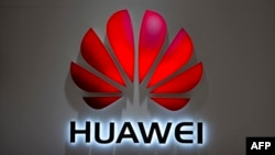 FILE - In this July 4, 2018, photo, the Huawei logo is seen at a Huawei store at a shopping mall in Beijing.