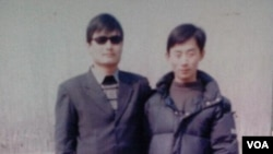 陳克貴(右)與陳光誠的合影(資料圖片)
