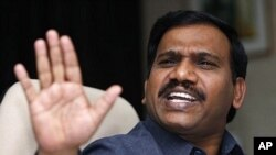 Indian Communications and Information Technology Minister A. Raja gestures while replying to journalists' questions (file photo)