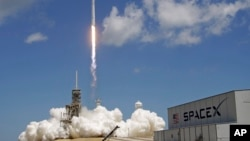 FILE - A Falcon 9 SpaceX rocket launches from Kennedy Space Center in Cape Canaveral, Fla., Aug. 14, 2017.