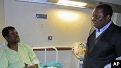 Zimbabwe's Prime Minister Morgan Tsvangirai visits Movement for Democratic Change [MDC] youth leader Yaya Kassim - who was attacked while visiting MDC supporters, allegedly by youths loyal to President Robert Mugabe's ZANU PF party - at a hospital in the