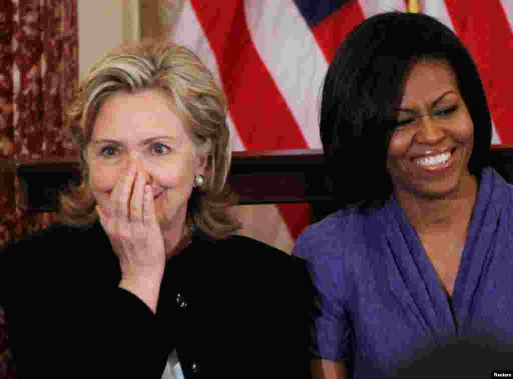 Secretaryn Clinton and first lady Michelle Obama share a laugh during their participation in the 2010 International Women of Courage Awards at the State Department in Washington, March 10, 2010.