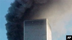 "A jet airliner is lined up on one of the World Trade Center towers in New York, in this Sept. 11, 2001,file photo. A report noted ""there is strong evidence that Iran facilitated the transit of al Qaida members into and out of Afghanistan, and that some of"