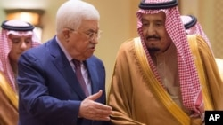 FILE - In this photo released by Al-Ekhbariya, Saudi King Salman, right, receives Palestinian President Mahmoud Abbas after he arrives in Riyadh, Saudi Arabia, Dec. 20, 2017.