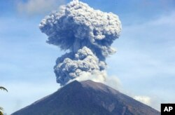 Mount Agung spews ash and smoke in Karangasem, Bali, Indonesia, July 3, 2018