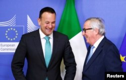 FILE - EU Commission President Jean-Claude Juncker and Irish Prime Minister Leo Varadkar meet in Brussels, Belgium, Feb. 6, 2019.