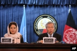 FILE - Tadamichi Yamamoto, United Nations Special Representative of the Secretary-General for Afghanistan (right) speaks during a press conference with Danielle Bell, United Nations Assistance Mission in Afghanistan, UNAMA, Human Rights Director, to discuss the release of the U.N. 2016 Annual Report on the Protection of Civilians in Armed Conflict, in Kabul, Afghanistan, Feb. 6, 2017.