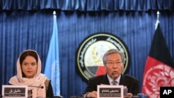 Tadamichi Yamamoto, United Nations Special Representative of the Secretary-General for Afghanistan, right, speaks during a press conference with Danielle Bell, United Nations Assistance Mission in Afghanistan, UNAMA, Human Rights Director, to discuss the release of the U.N. 2016 Annual Report on the Protection of Civilians in Armed Conflict, in Kabul, Afghanistan, Monday, Feb. 6, 2017.