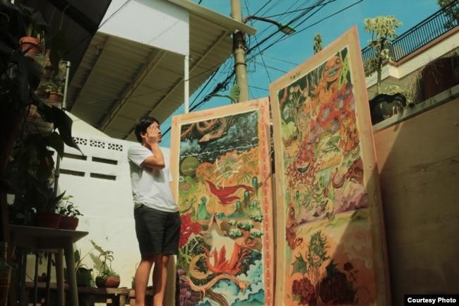 Atreyu Moniaga bersama karya lukisannya (dok: Atreyu Moniaga)