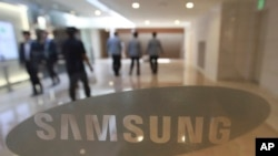 FILE - The corporate logo of Samsung Electronics Co. is seen at its shop in Seoul, South Korea.