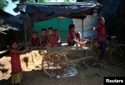Rohingya refugee children play in Kutupalong refugee camp near Cox's Bazar, Bangladesh, Nov. 6, 2017.