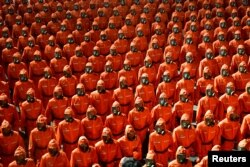 Personnel in orange hazmat suits march during a paramilitary parade held to mark the 73rd founding anniversary of the republic at Kim Il Sung square in Pyongyang in this undated image supplied by North Korea's Korean Central News Agency on September 9, 20