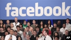 FILE - President Barack Obama, accompanied by Facebook CEO Mark Zuckerberg, speaks during a town hall at Facebook headquarters, Palo Alto, California, April 20, 2011.