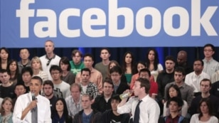 President Barack Obama, accompanied by Facebook CEO Mark Zuckerberg, speaks during a town hall meeting to discuss reducing the national debt at Facebook headquarters in Palo Alto, California, April 20, 2011.