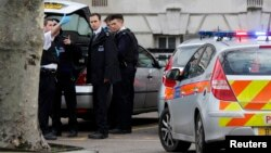 FILE - Police officers attend to the scene of a stabbing in southeast London, Britain, Feb. 1, 2013. Metropolitan Police recorded 40,147 offenses involving a knife or bladed weapon in the first three months of this year.