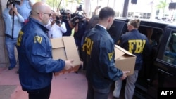 FBI agents take boxes with documents from the headquarters of the CONCACAF soccer organization after a raid on May 27, 2015 in Miami Beach, Florida.