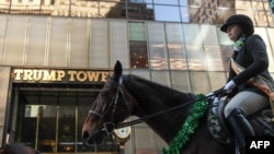 Members of the County Carlow Association ride horses past Trump Tower on Fifth Avenue during the annual St. Patrick's Day parade, March 17, 2017, in New York City.
