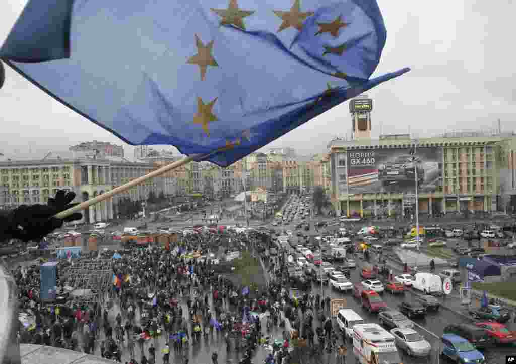 A view of a rally in support of integration with the European Union, as a supporter waves a European flag from a building top in Kyiv, Nov. 29, 2013.