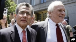 Former Goldman Sachs director Rajat Gupta, left, and attorney Gary P. Naftalis, leave federal court, New York, June 15, 2012.