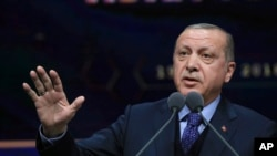 FILE - Turkey's President Recep Tayyip Erdogan speaks in Ankara, March 19, 2018. Erdogan has said that candidates deemed sympathetic to the PKK who win in the March 2019 local elections will be removed.