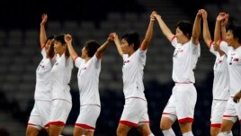FILE - North Korea's players celebrate after winning their women's Group G football match against Colombia at the London 2012 Olympic Games in Glasgow, Scotland Jul. 25, 2012.
