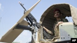 FILE - An Afghan National Army soldier stands guard in Camp Khogyani in Nangarhar province, east of Kabul, a region where homegrown militants loyal to the Islamic State group have made some inroads, Aug. 5, 2015.