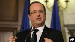 French President Francois Hollande gestures speaks during a news conference in Athens, Greece, February 19, 2013.