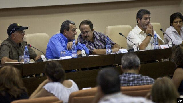 Mauricio Jaramillo, a spokesman and top leader of the Revolutionary Armed Forces of Colombia, or FARC, second from left, talks with FARC member Andres Paris during a press conference in Havana, Cuba, September 6, 2012.