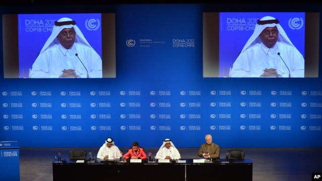 UN Convention on Climate Change Executive Secretary Christiana Figueres, second left, speaks during a press conference alongside Qatar's Deputy Prime Minister and president of the 18th United Nations Convention on Climate Change, Abdullah bin Hamad Al-Attiyah, second and on screens in Doha, Qatar, Dec. 3, 2012.