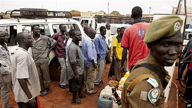 Fighting in Abyei has led to extreme fuel shortages in Wau, where Southern Sudanese wait in line to purchase petrol, May 25, 2011.