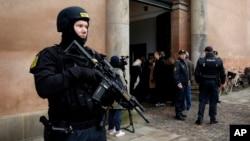 FILE - Heavily armed police officers stand in front of Copenhagen City Court, March 10, 2016, in Copenhagen, Denmark.