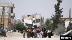 Mutanen dake ficewa daga Aleppo bayan da dakarun 'yan tawaye suka fasa kawanyar da aka yi masu