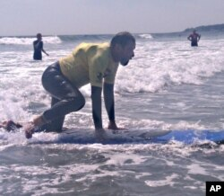 Stricken with polio at an early age, Brian Foss, 57, uses crutches but still enjoys skiing, bicycling and surfing.