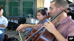 American and Vietnamese musicians rehearse