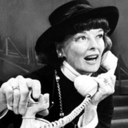 """Katharine Hepburn uses the telephone in a scene from the musical """"Coco"""""""