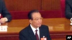 中國總理溫家寶在人大代表會議上發表政府工作報告。