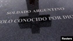 "FILE - A tombstone bearing the phrase ""Argentine soldier only known by God"" is seen at Darwin cemetery, where the remains of Argentine soldiers who died during the Falklands War are buried, in the Falkland Islands, March 11, 2012."