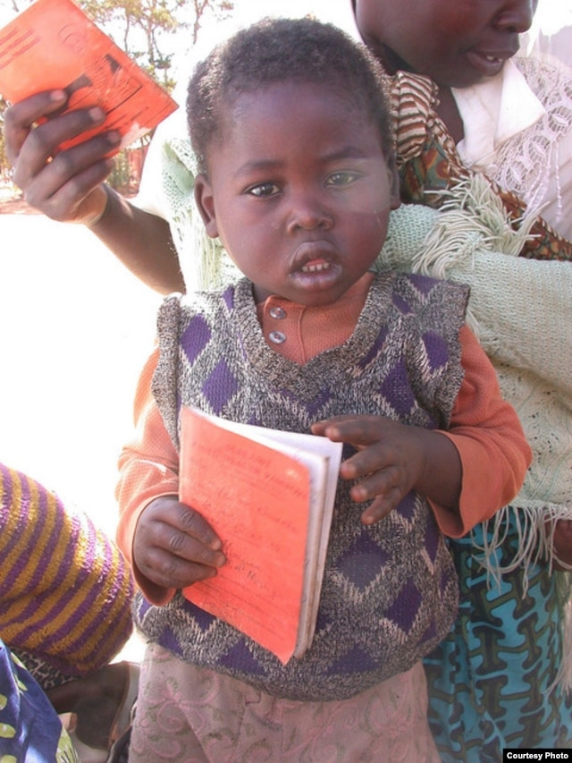 Parents and children in Malawi use health passports as a portable medical record. (Alain HY Cheng)