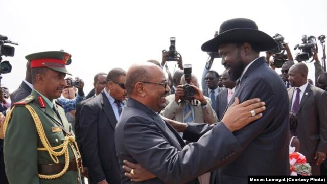 South Sudanese President Salva Kiir (r.) hugs his Sudanese counterpart Omar al Bashir on his arrival at Juba airport on Friday, April 12, 2013. The Sudanese president was visiting South Sudan for the first time since it split from Sudan in 2011.