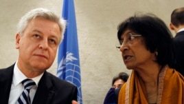 U.N. High Commissioner for Human Rights Navi Pillay (R) talks to Remigiusz Henczel, President of the Human Rights Council before the 22nd session of the Human Rights Council at the United Nations in Geneva Feb. 25, 2013.