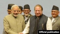 Prime Minister Muhammad Nawaz Sharif shaking hands with Indian Prime Minister Mr. Narendra Modi at the closing ceremony of the 18th SAARC Summit in Kathmandu, Nepal on November 27, 2014.