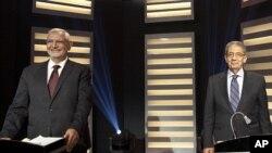 Misr prezidentligiga nomzodlar - Amir Musa (o'ngda) hamda Abdul Munim Abul Futuh telekanal orqali namoyish etilgan saylovoldi bahsida. Qohira, Misr, 10-may, 2012-yil.