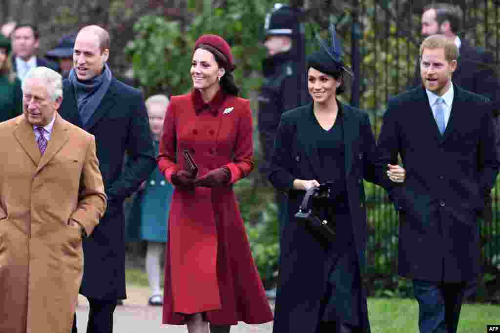 (L-R) Britain's Prince Charles, Prince of Wales, Britain's Prince William, Duke of Cambridge, Britain's Catherine, Duchess of Cambridge, Meghan, Duchess of Sussex and Britain's Prince Harry, Duke of Sussex arrive for the Royal Family's traditional Christmas Day service at St. Mary Magdalene Church in Sandringham, Norfolk, eastern England.
