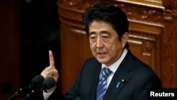日本首相安倍晋三10月15日在东京