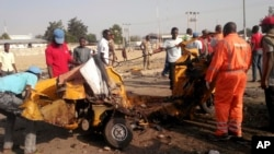 FILE - People clear debris after an explosion in Maiduguri, Nigeria, Oct. 29, 2016. Twin explosions from female suicide bombers suspected to be with Boko Haram killed nine people and injured more than 20 in Maiduguri.