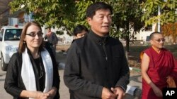 U.S. Under Secretary of State for Civilian Security, Democracy, and Human Rights Sarah Sewall, left, walks out of the airport with the Tibetan prime minister Lobsang Sangay, second from right, on her arrival in Dharmsala, India, Friday, Jan. 15, 2016. Sewall is scheduled to see the Tibetan spiritual leader Dalai Lama at his residence on Saturday. (AP Photo/Ashwini Bhatia)