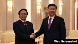Trưởng ban Đối ngoại Trung ương Hoàng Bình Quân (trái) hội kiến Chủ tịch Trung Quốc Tập Cận Bình. Ảnh: TTXVN (Ảnh chụp màn hình trang web vnexpress.net)