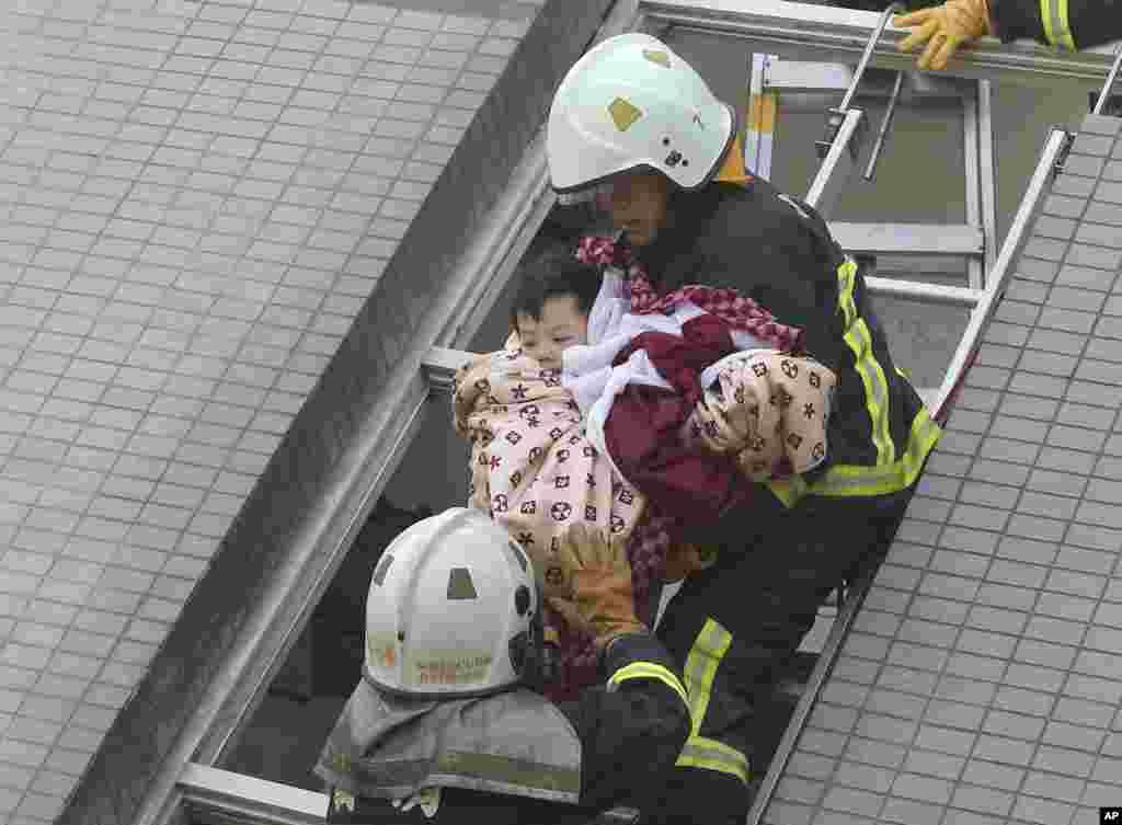 A child is rescued from a collapsed building.